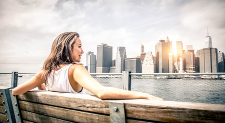 Beautiful woman portrait with Manhattan skyline in the background