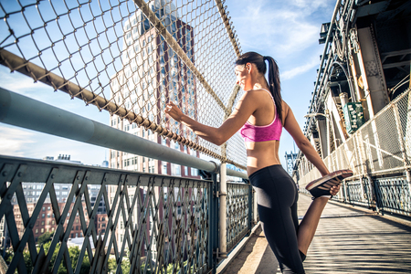 Woman running in Brooklyn. Urban runner on the move in New York