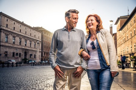 Senior couple at the Vaticano, Rome - Happy tourists visiting italian famous landmarks