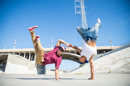 subculture: Two bbys ding some stunts - Street artist breakdancing outdrs