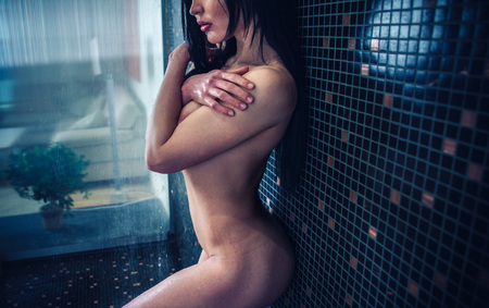 chinese sex: Beautiful woman taking shower in her bathroom Stock Photo