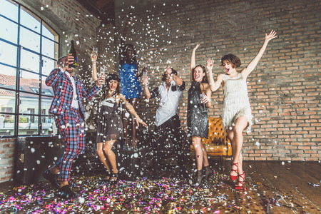 Multicultural group of friends having party - Happy people having fun and celebrating at home Stok Fotoğraf