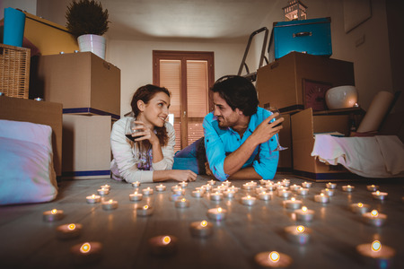 moving box: Couple moving to a new home - Happy married people buy a new apartment to start new life together