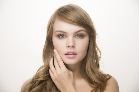 Beautiful young woman with clean fresh skin on white background -  Facial treatment, Cosmetology , Beauty and spa concepts