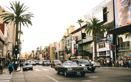 LOS ANGELES - OCTOBER 12, 2015: View of Hollywood Boulevard at sunset. In 1958, the Hollywood Walk of Fame was created on this street as a tribute to artists working in the entertainment industry Editorial