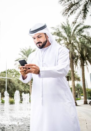 outoors: Arabic businessmen in Dubai Stock Photo