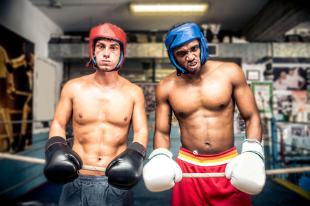Boxers fighting in a gym