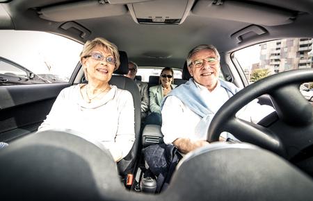 車を運転の高齢者のグループ 写真素材