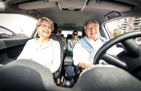 Group of seniors driving in the car Banco de Imagens