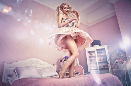Blonde doll girl in a toy house Stock Photo