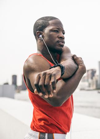 Sportive man training outdoors