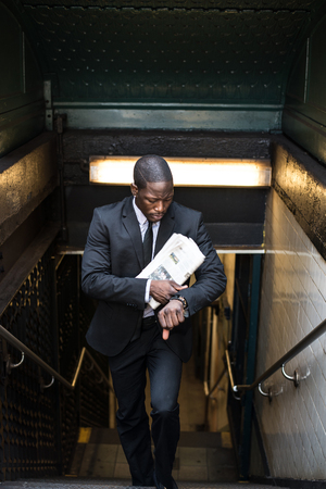 Businessman in full suit at Wall Street subway metro station