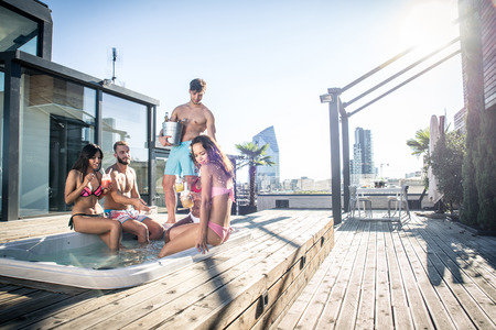 Multi-ethnic group of friends having party on  rooftop - Happy people bonding and having fun Фото со стока - 90575171