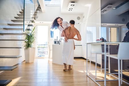 Beautiful couple in a luxury loft - Boyfriend and girlfriend in their daily life at home