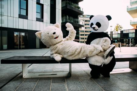 Panda and teddy bear having fun around the city