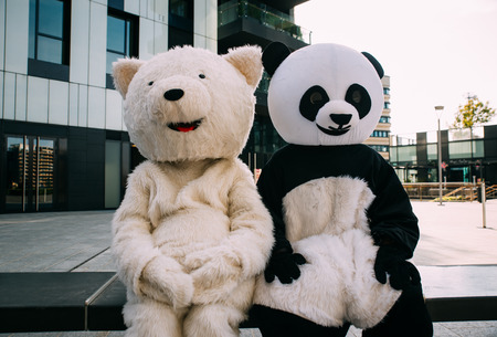 Panda and teddy bear having fun around the city