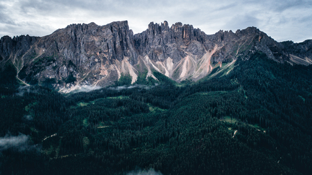 Aeril view of mountains and forest in europe on the alps