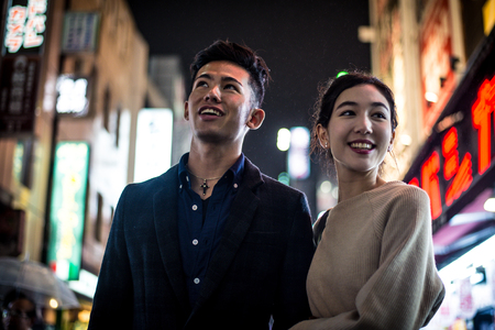 Young japanese couple spending time together in Tokyo Stock Photo - 91239262