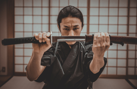 Samurai training in a traditional dojo, in Tokyo Stock Photo