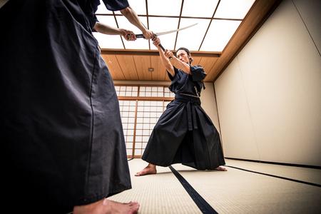 Samurai training in a traditional dojo, in Tokyo Stock Photo