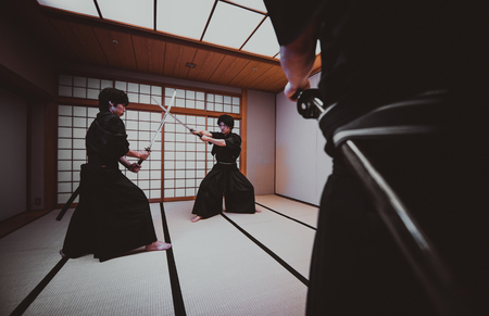 Samurai training in a traditional dojo, in Tokyo Фото со стока