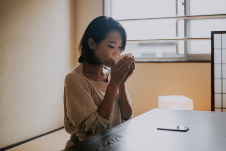 Beautiful japanese woman, lifestyle moments in a traditional Tokyo apartment