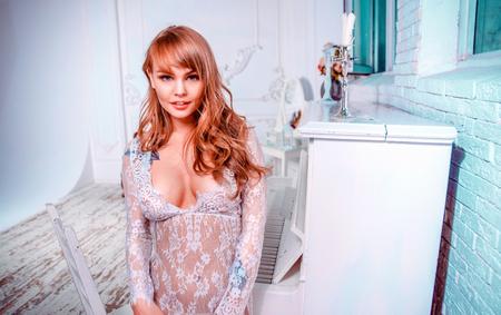 Beautiful woman posing in her apartment