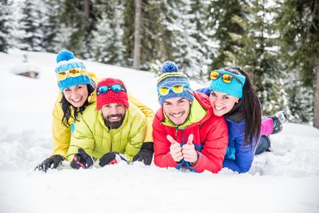 Group of friends with ski on winter holidays - Skiers having fun on the snow Zdjęcie Seryjne