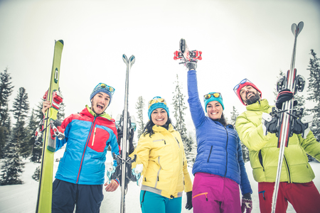 Group of friends with ski on winter holidays - Skiers having fun on the snow 写真素材