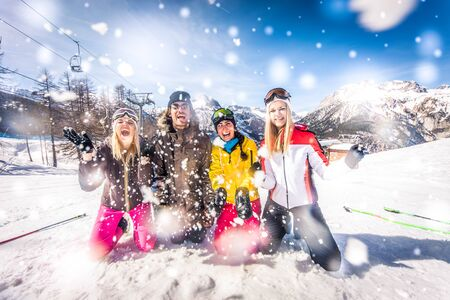 Group of friends with ski on winter holidays - Skiers having fun on the snow Banco de Imagens