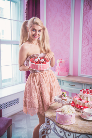 Beautiful woman with desserts and cakes - Fashion model in a pastry shop