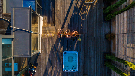 Group of friends having fun on a penthouse terrace, view from above Stok Fotoğraf