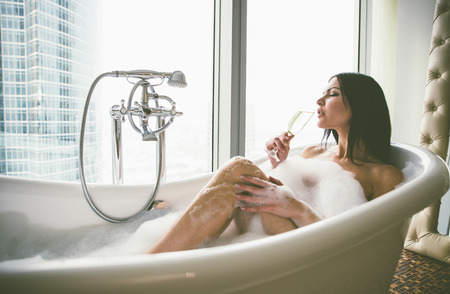 Seductive woman taking relaxing bath in her jacuzzi 스톡 콘텐츠