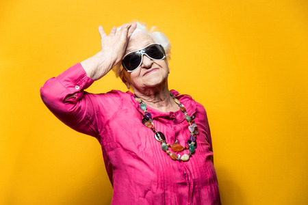Grandmother portrait set in the studio. Concepts about seniority Standard-Bild
