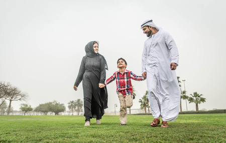 Arabic family playing with child Stock Photo