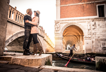 Beautiful couple in Venice, Italy - Lovers on a romantic date and kissing in Saint Mark Square, Venice