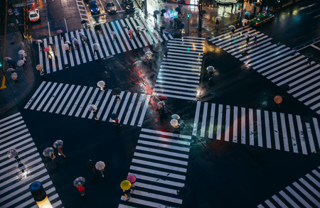 Crossing in Tokyo. Aerial view of people crossing the street