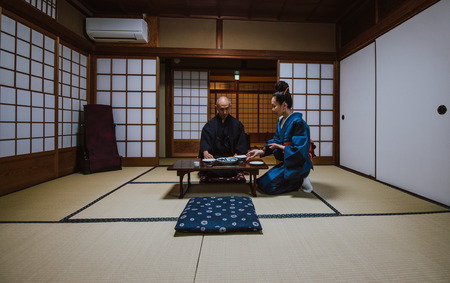 Senior japanese couple moments in a traditional house