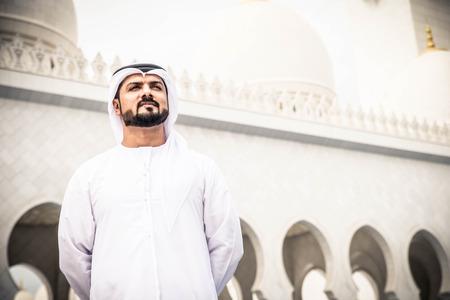 Arabian man at Sheikh Zayed Grand Mosque in Abu Dhabi, United Arab Emirates.