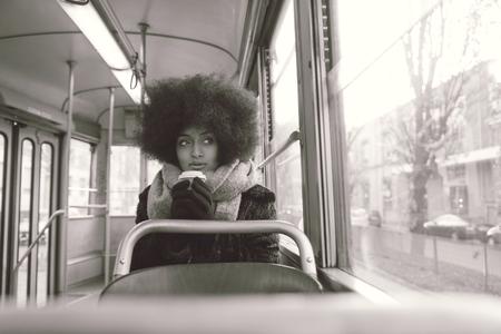 Beautiful woman driving on a bus - Afroamerican girl portrait outdoors