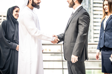 Arabic and western business people portrait. Motivational concept Stockfoto