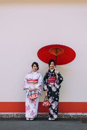 Two japanese girls wearing kimonos traditional clothes, lifestyle moments