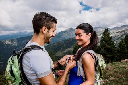 Couple making trekking on the mountain