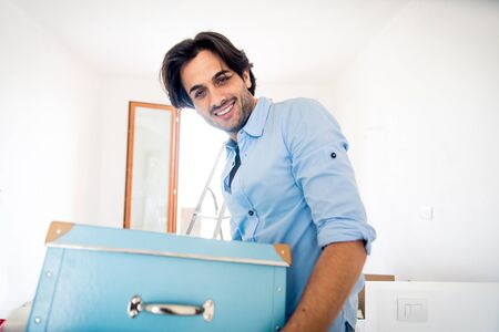 Man moving to a new home - Happy married people buy a new apartment to start new life together Stock Photo