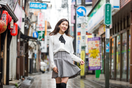 Pretty japanese student poirtait outdoors - Asian girl going to college school