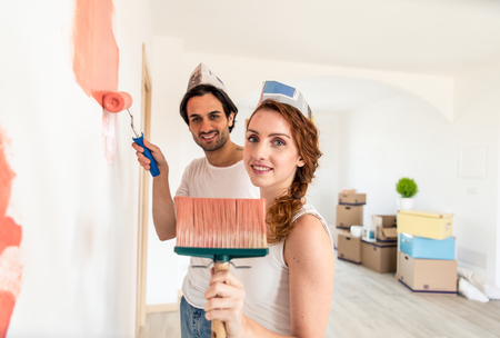 Couple moving to a new home - Happy married people buy a new apartment to start new life together