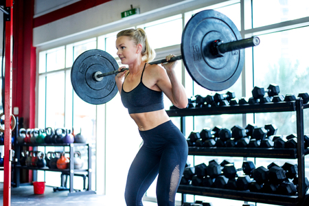 Muscular athlete training in a crossfit gym - Functional training workout in a gym