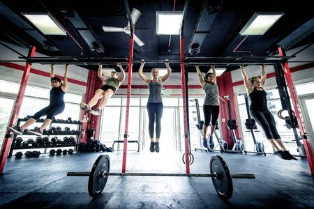 Muscular athletes training in a crossfit gym - Functional training workout in a gym 스톡 콘텐츠
