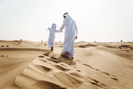Father and son spending time in the desert Banco de Imagens