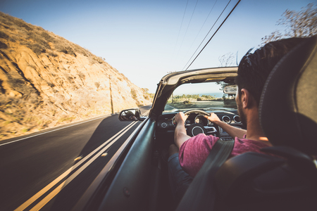 Man driving convertible car in Los angeles, santa monica Stock Photo
